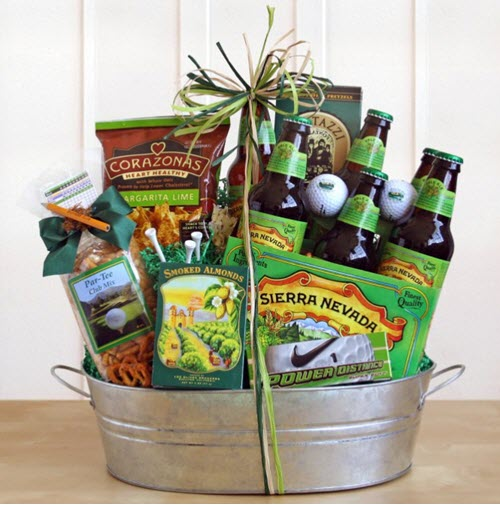 Silver tub filled with green golf-related products, including beer, snacks, golf balls and tees.
