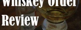"blurred out picture of whiskey sample and dram with the text reading ""whiskey order review"""