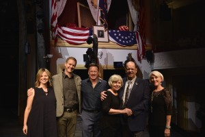 "Two of the creators of the musical ""Come from Away"" stand on the Ford's Theatre stage under the presidential box with four individuals whose experience the musical is written about."