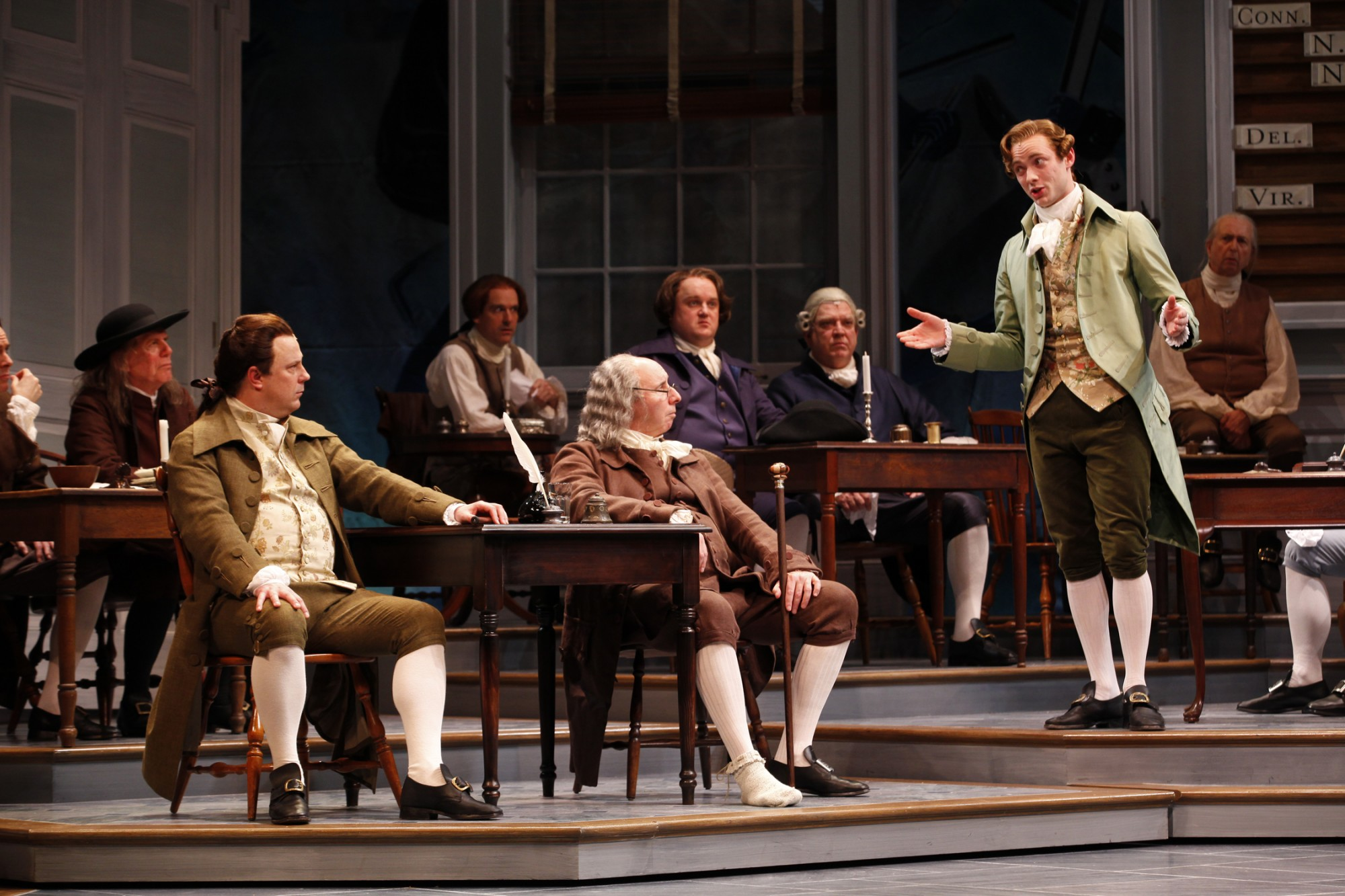 "(At Right) Gregory Maheu as Edward Rutledge addresses the Continental  Congress in the Ford's Theatre production of ""1776,"" directed by Peter  Flynn."