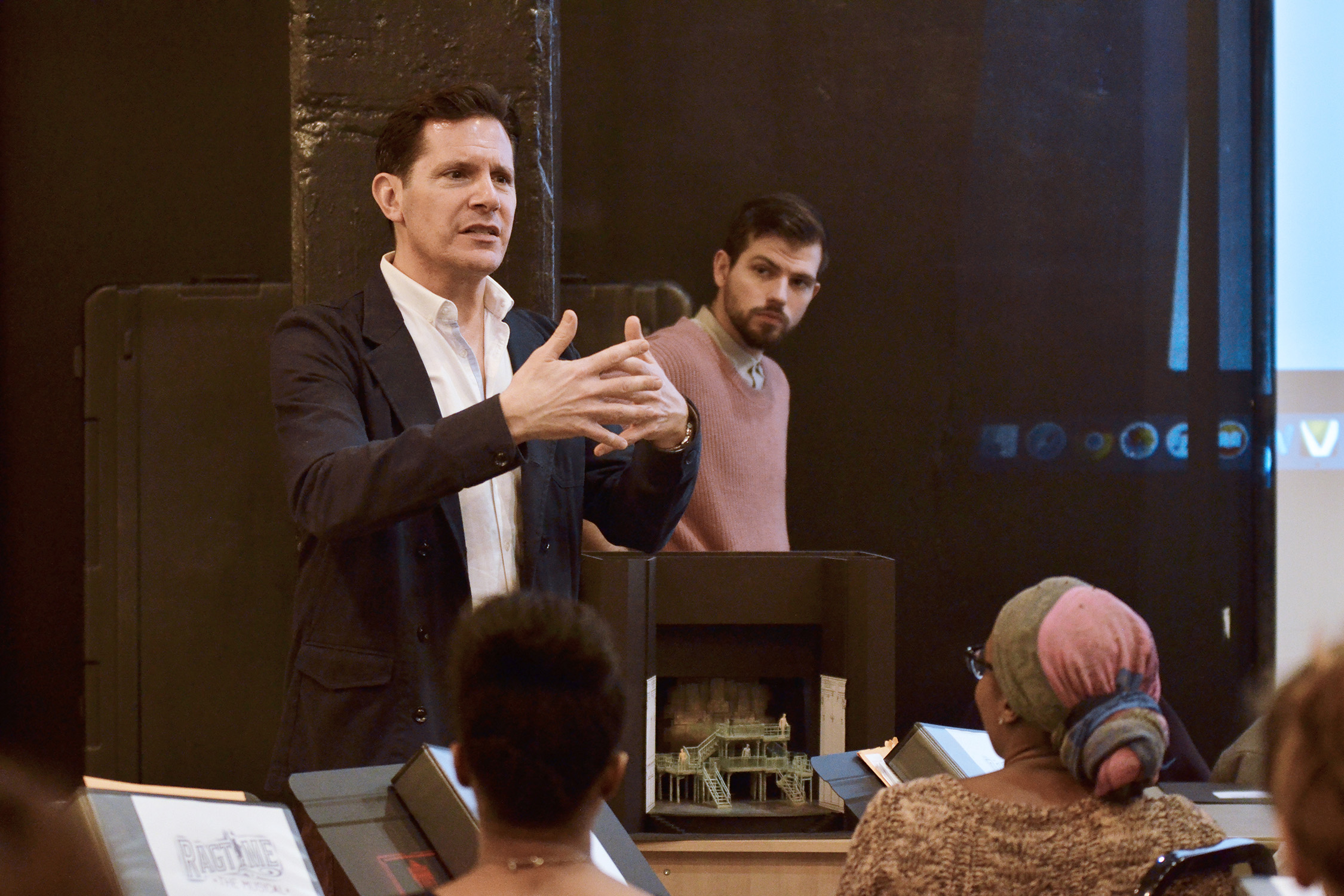 Peter Flynn speaks to the cast in a rehearsal room.
