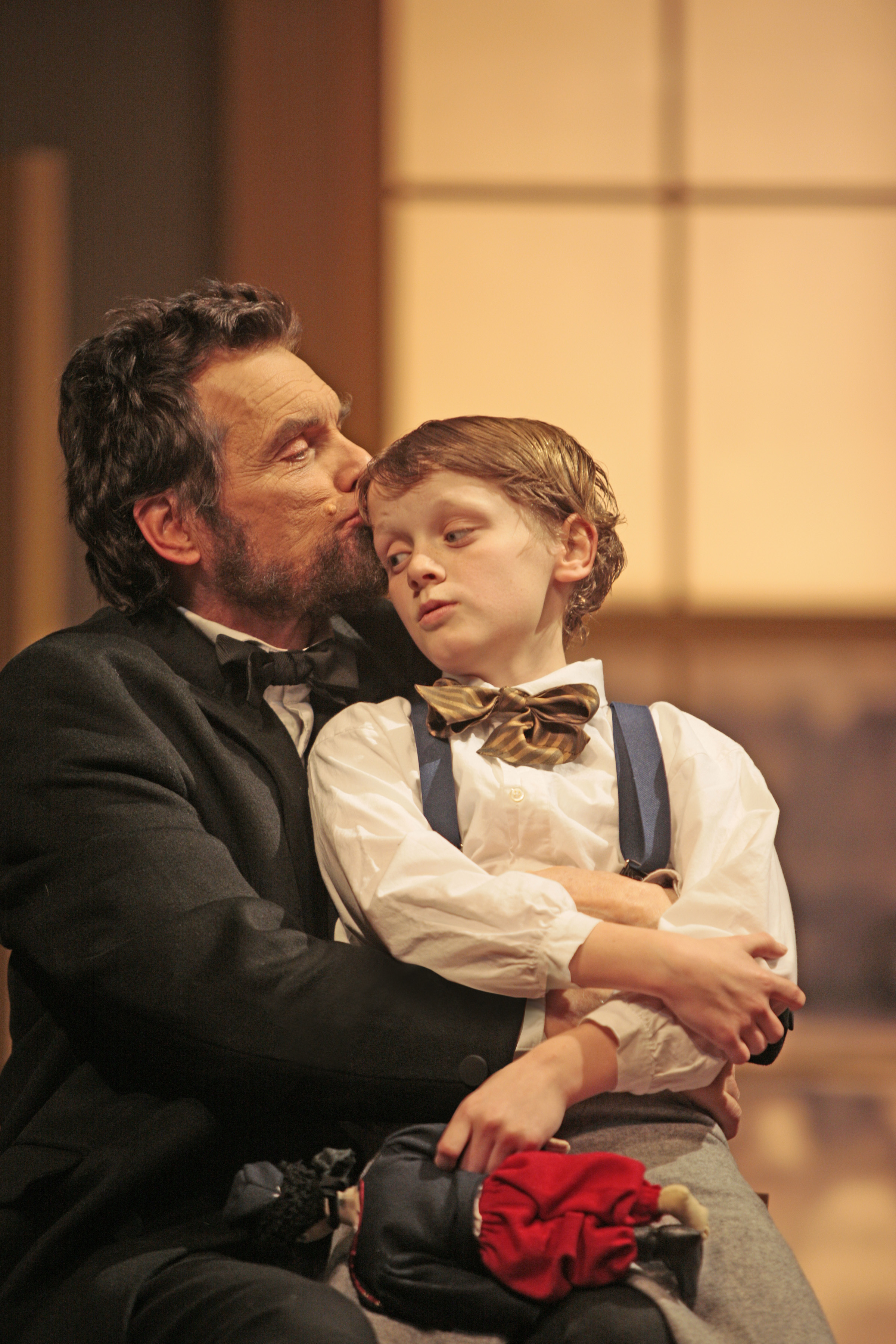 "Actors embrace as they portray Abraham Lincoln and his young son, Tad, on stage in a performance of ""The Heavens Are Hung in Black"" at Ford's Theatre."