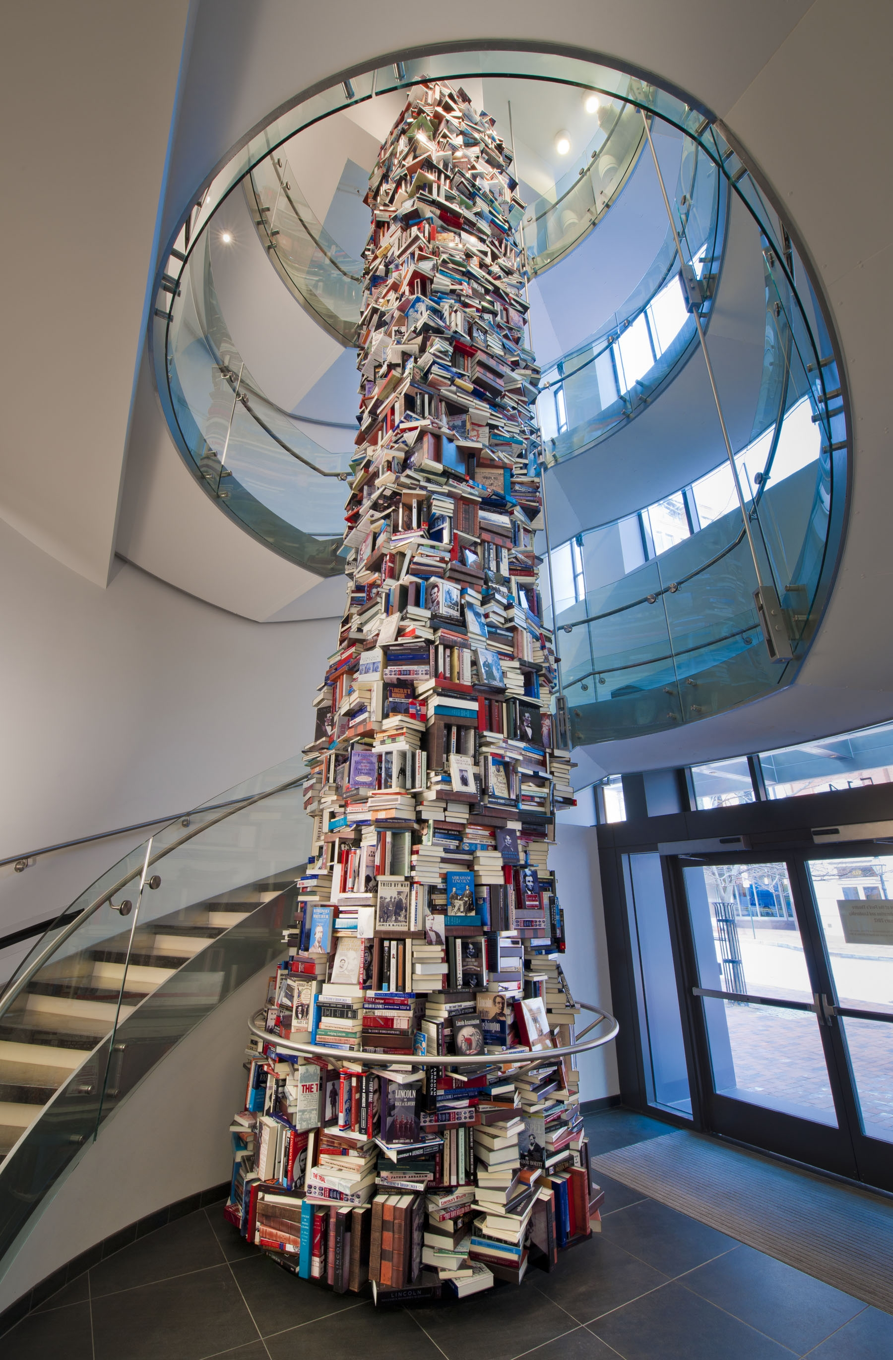 a 34ft tower of books about Abraham Lincoln is pictured here. The painted aluminium book jackets surround a structural column and reach from floor to ceiling in the Ford's Center for Education atrium
