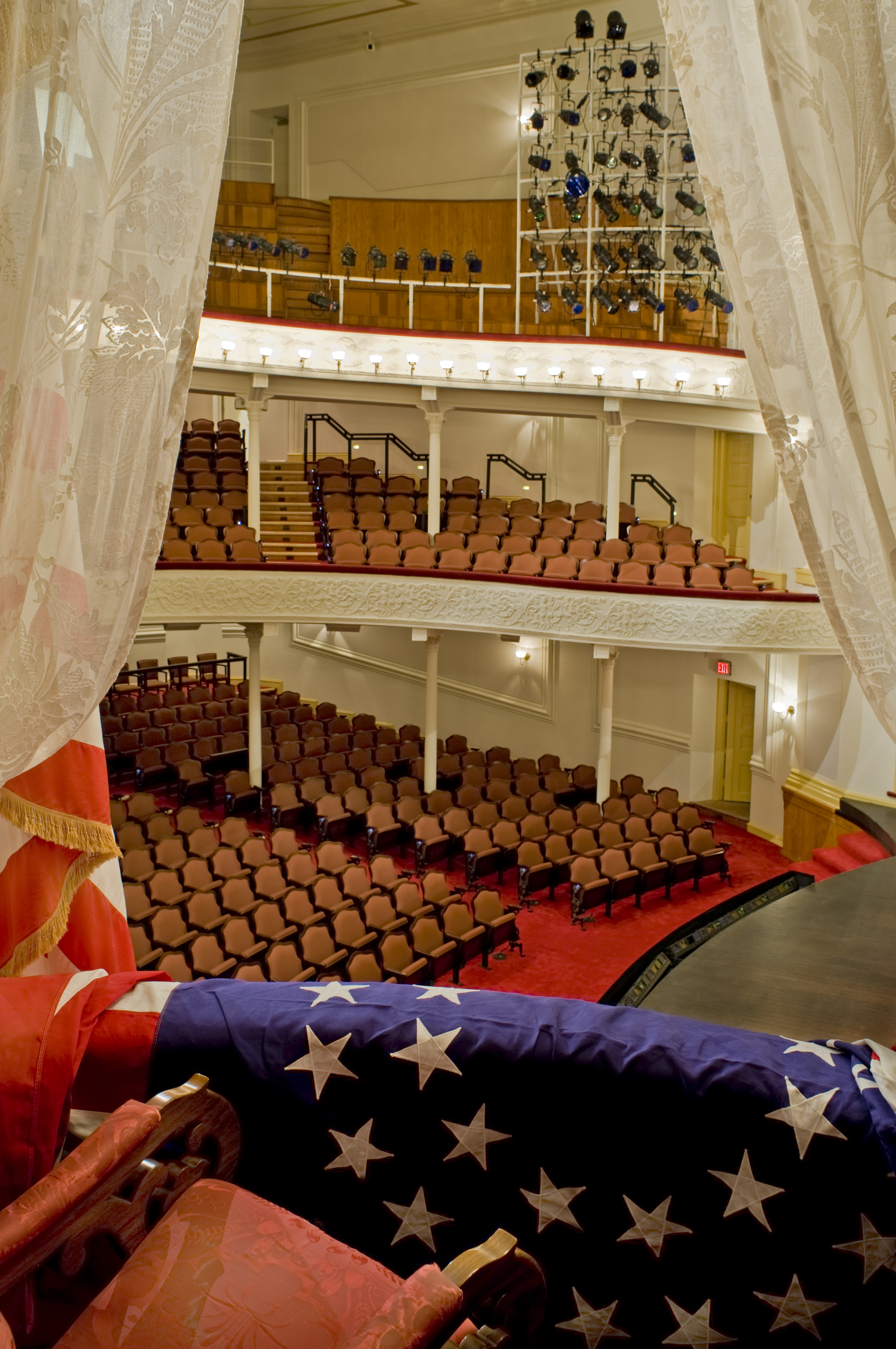 Image shows a view from the Presidential Box looking out toward the Ford's Theatre audience seating areas. It is a view President Lincoln would have seen from this spot on the nights he attended performances at Ford's Theatre during the 1860s.