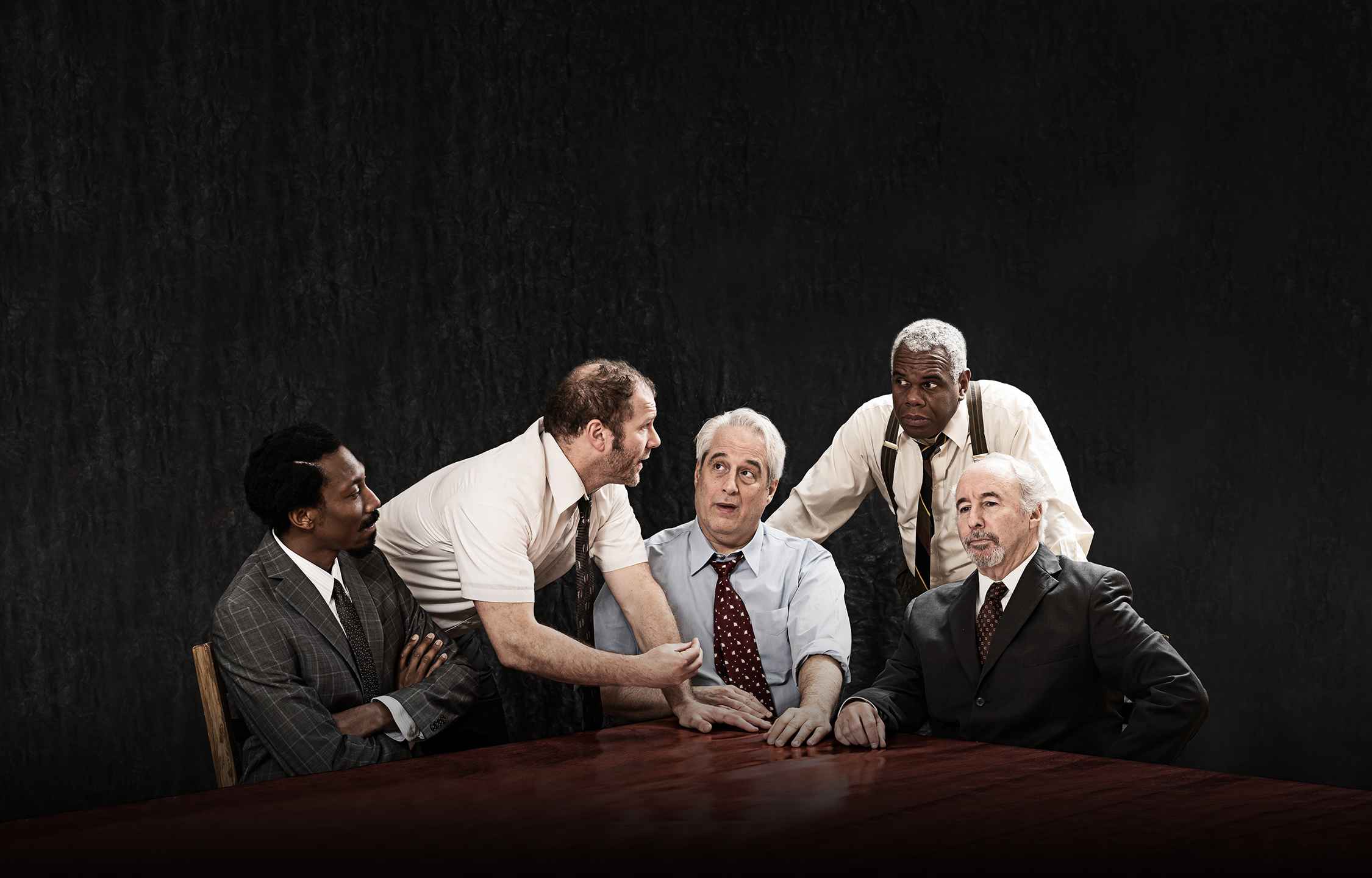 "Six actors (three white men, three black men) debate around a table. Image is of the Ford's Theatre 2019 cast of ""Twelve Angry Men."" Photo by Scott Suchman."