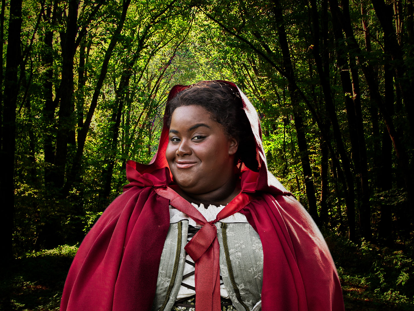 "An African-American Actress (Jade Jones) is shown in a red riding hood, standing in a wooded forest. This is for the upcoming Ford's Theatre production of Stephen Sondheim's ""Into the Woods"" (March-May 2019)."