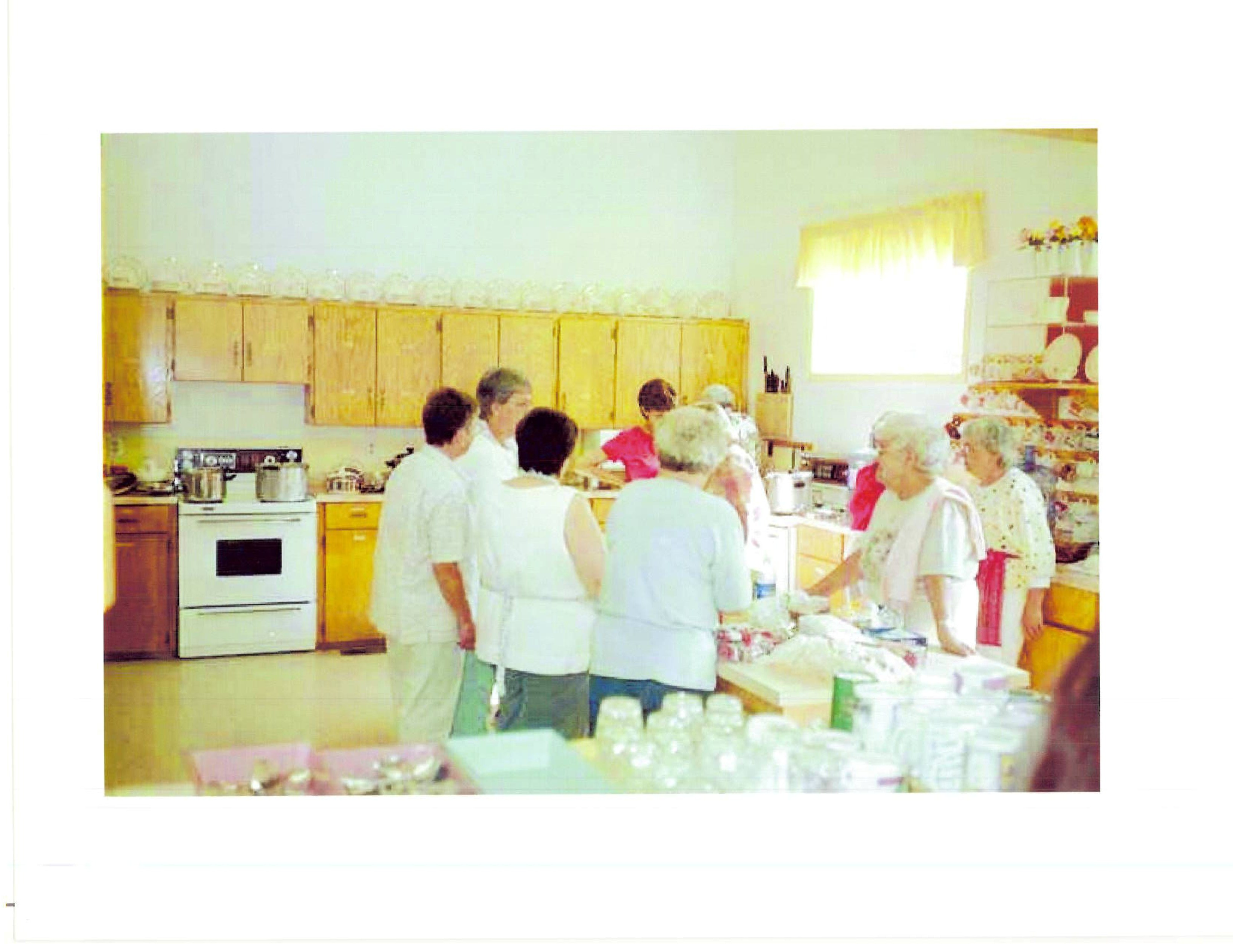 Local women from the church preparing hot meals. Photo courtesy Bob Beard and Richard Ross.