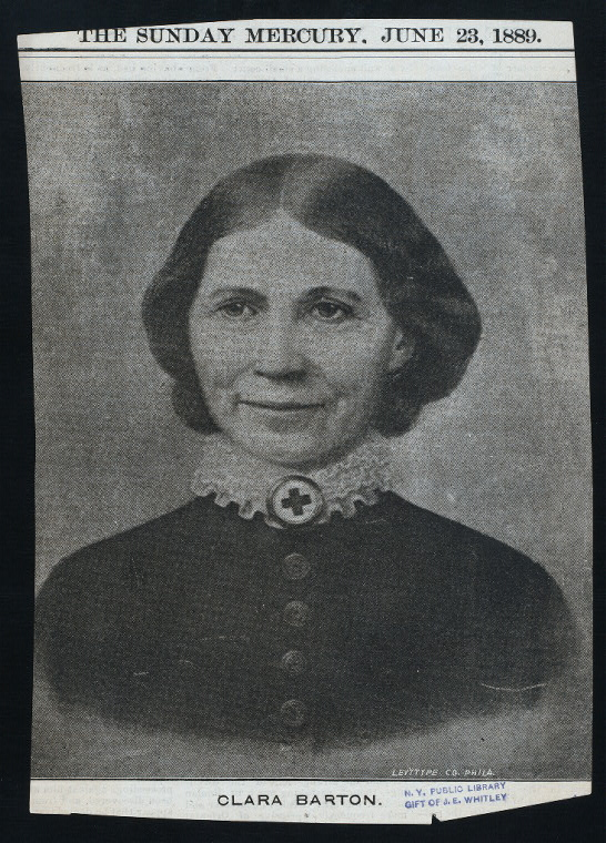 B&W image of Civil War nurse Clara Barton. She is dressed in a dark plain long sleeved corseted blouse with high color. Her hair is pulled back against her face with a part down the middle.