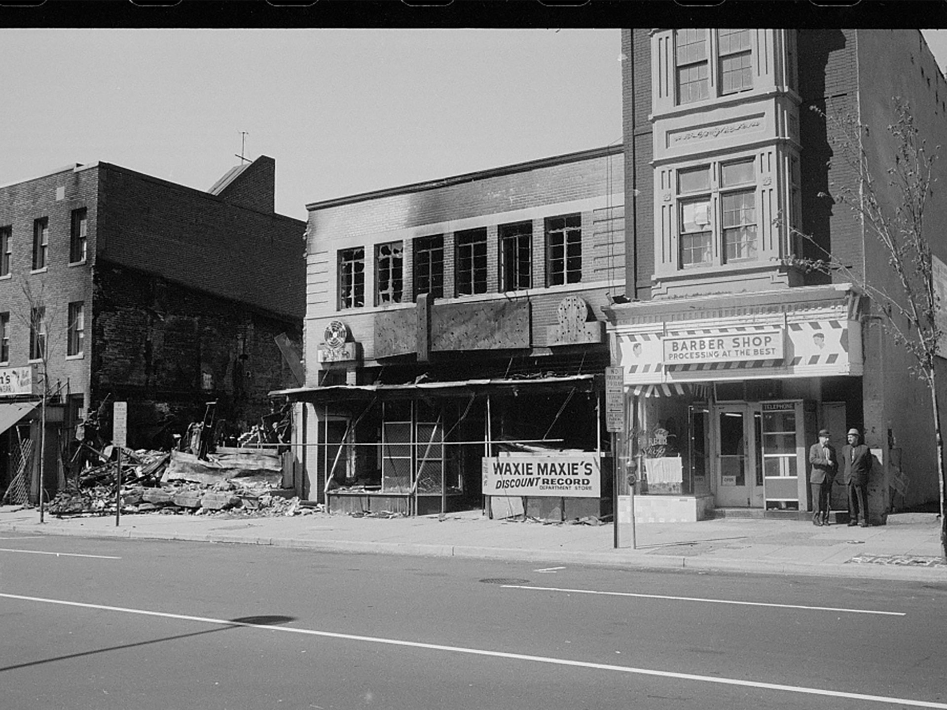 Section of Fourteenth Street NW where rioting broke out following Martin Luther King, Jr.'s assassination in 1968. Black and white photograph from the Library of Congress