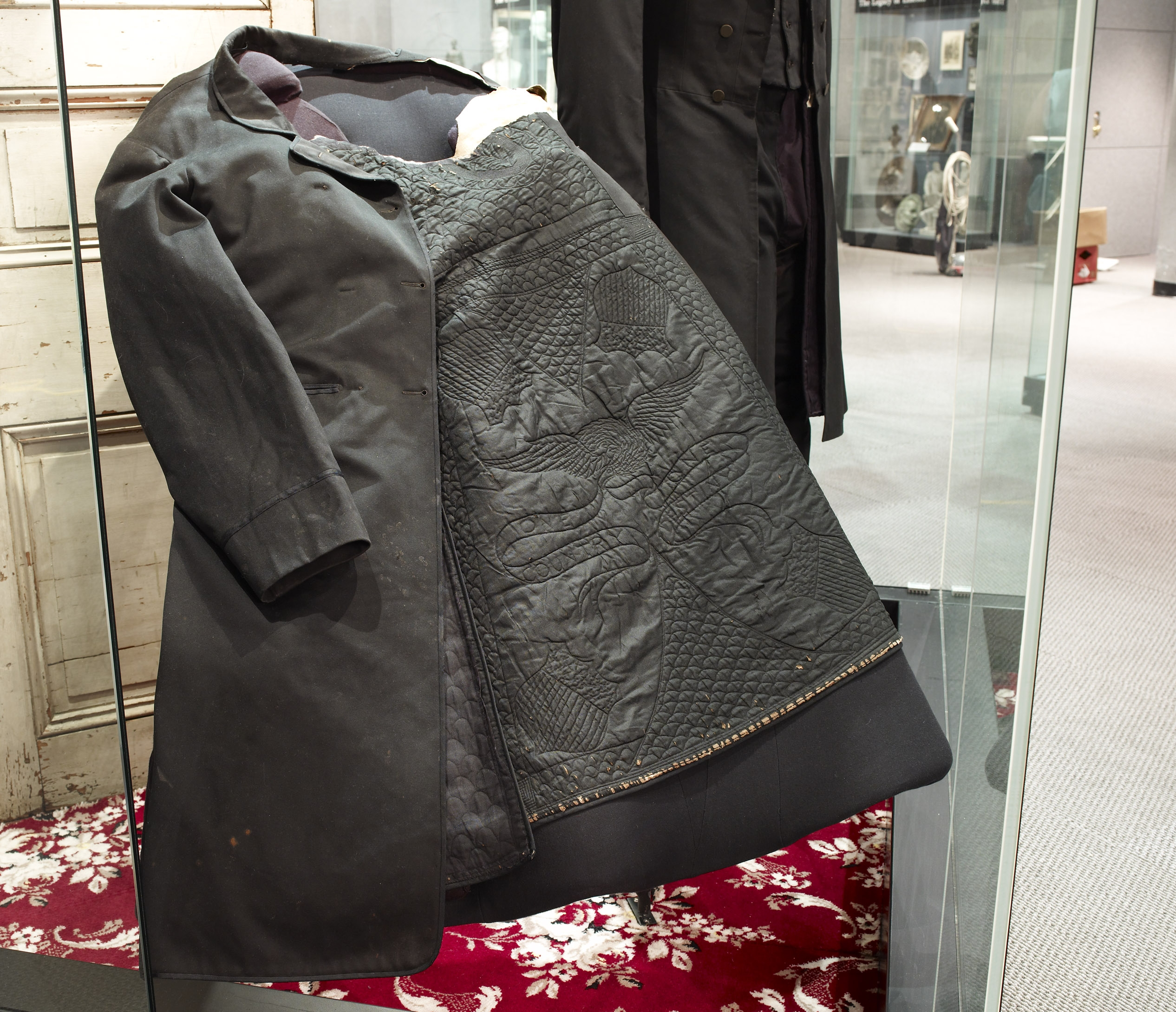 Museum case displays Lincoln's Frock Coat.