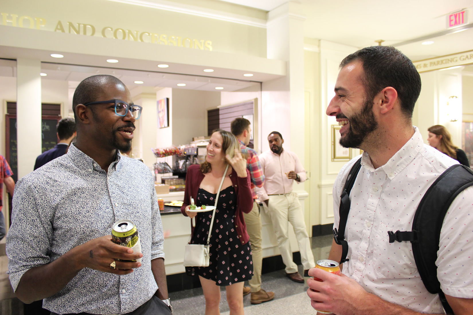 Two young men share a laugh in the lobby of Ford's Theatre during a Generation Abe Museum Night event.