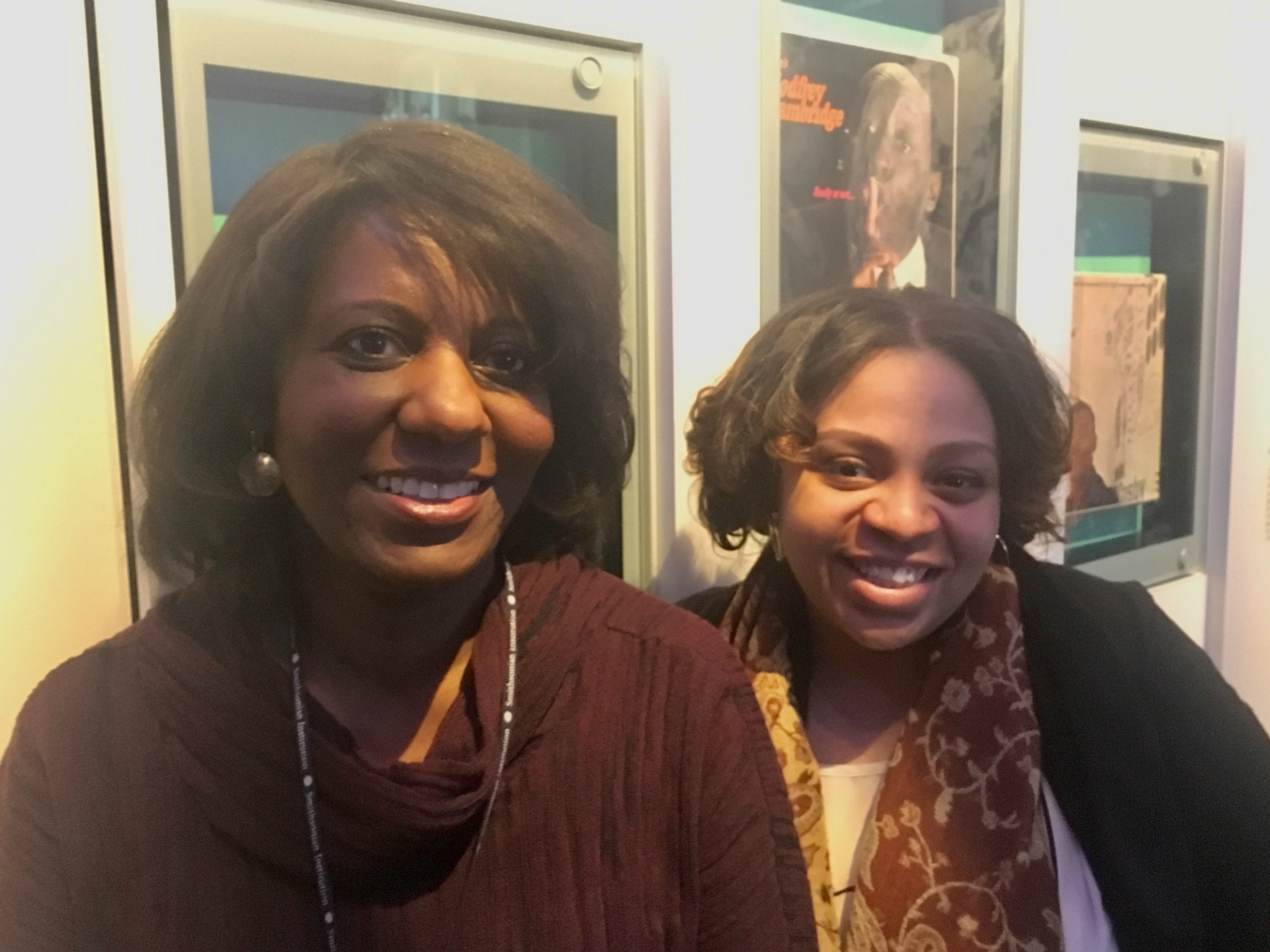 Curator and Ford's staff stand near one of the wall exhibits of text at the Smithsonian's Natoinal Museum of African American History and Culture