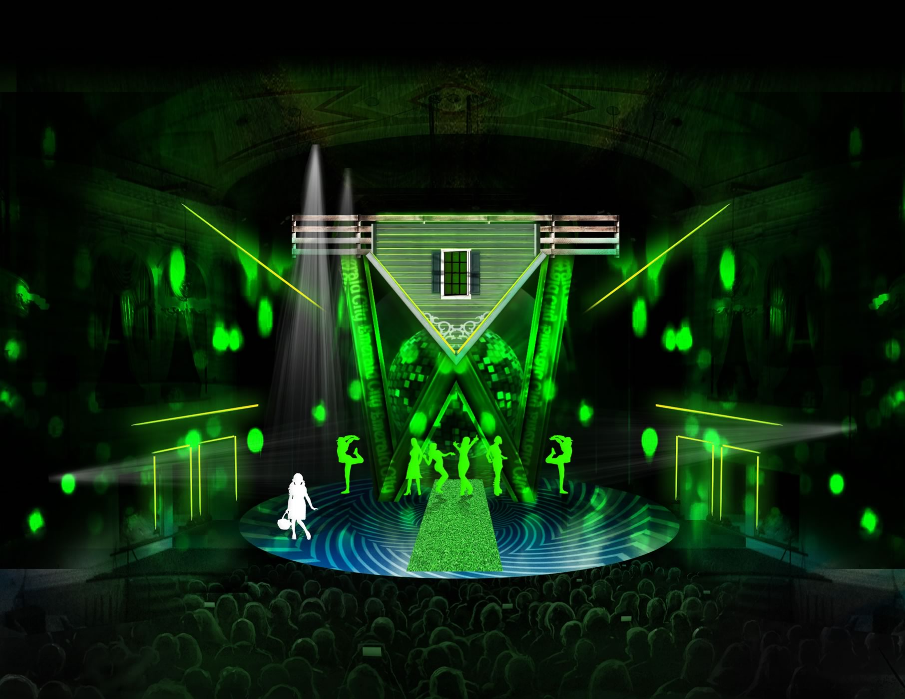 set design for The Wiz in the Emerald City scene includes dramatic kelly-green lighting in directed beams all over the stage, an inverted house with peaked roof floating above the stage.