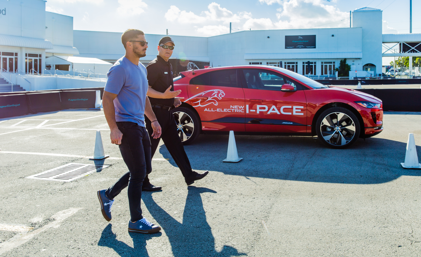 men walking by jaguar i pace car