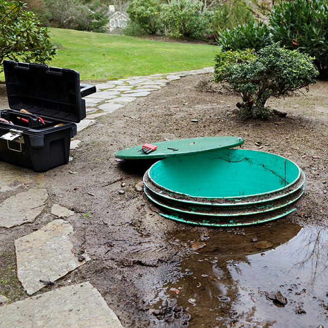septic maintenance with flooded front yard