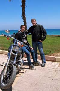 Dave and his son wearing their Summer Riding Jackets in front of the Red Sea.
