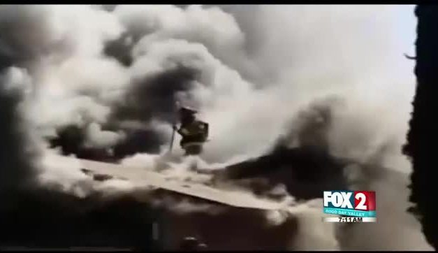 Brave Firefighter Collapses Through a Burning Roof: Caught on Tape!