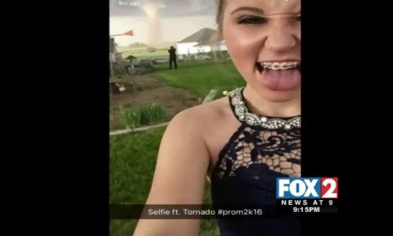 Caught on Camera: Couple Snap Prom Pics in front of Tornado