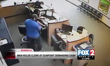 Police Search For Man Who Holds Clerk At Gunpoint