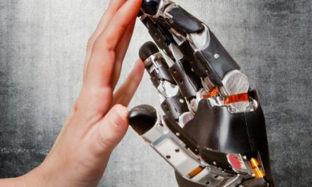 Mind-controlled robot hand helps paralyzed man feel touch