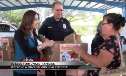Mission Police pass out meal boxes to families