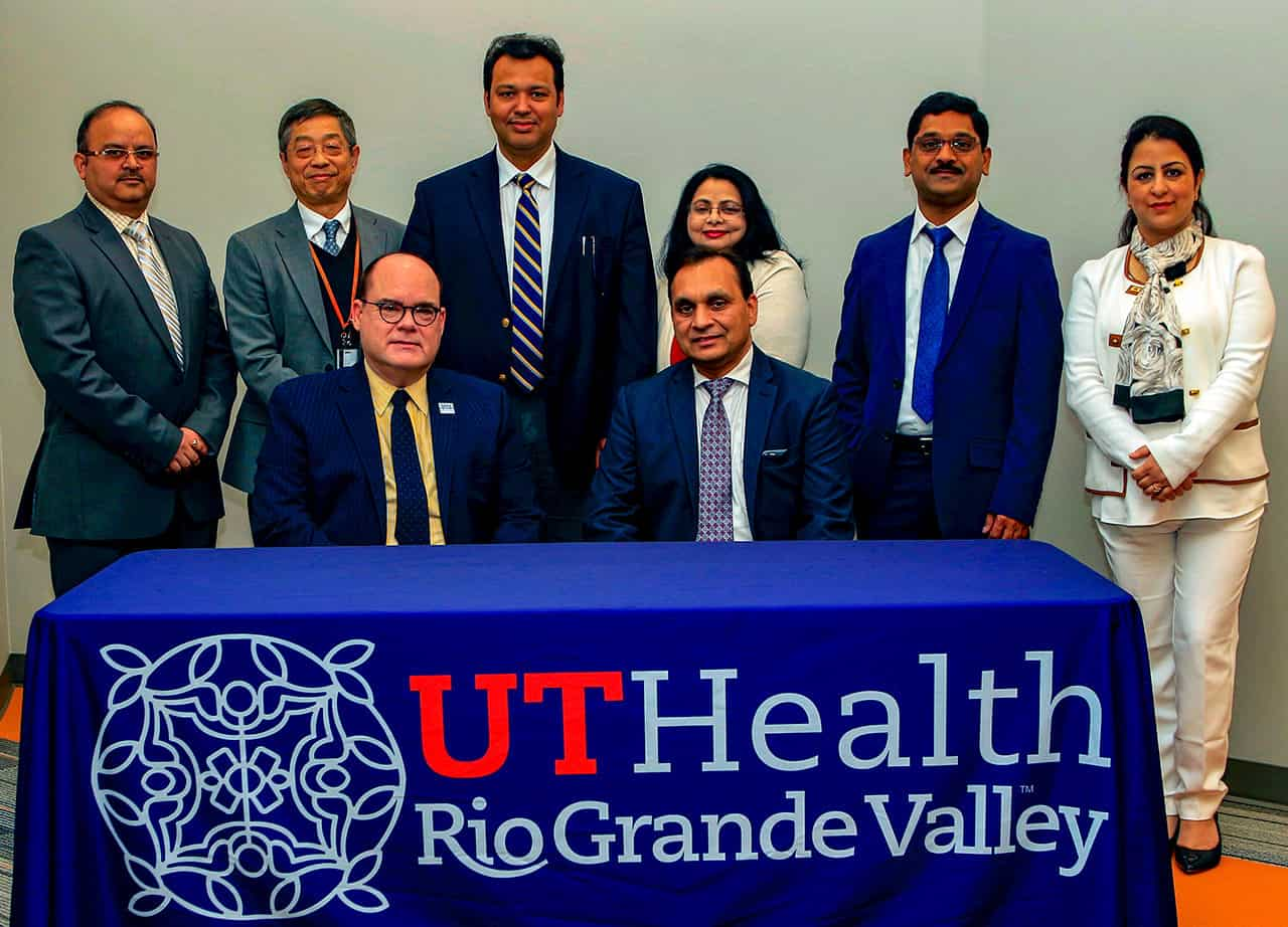 Featured, seated, from left: Dr. John H. Krouse, Executive Vice President for Health Affairs, University of Texas Rio Grande Valley and Dean, UTRGV School of Medicine, recently welcomed Dr. Subhash C. Chauhan, Ph.D. as Founding Director of the South Texas Center of Excellence in Cancer Research and Chair of the Department of Immunology and Microbiology at the UTRGV School of Medicine. Standing are members of Chauhan's team along with another UTRGV leader, featured from left: Dr. Manish Tripathi; Dr. Andrew Tsin, UTRGV Associate Dean of Research; Dr. Bilal Hafeez; Dr. Meena Jaggi; Dr. Murali Yallapu; and and Dr. Sheema Khan. The UTRGV School of Medicine recently welcomed its new cancer immunology team with a signing ceremony on Tuesday, April 9, 2019 at the UTRGV/UT Health RGV Biomedical Research Building, which is located on DHR Health's South Campus in McAllen.  Photograph Courtesy THE UNIVERSITY OF TEXAS RIO GRANDE VALLEY SCHOOL OF MEDICINE