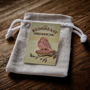 Receive a free Redbreast pin