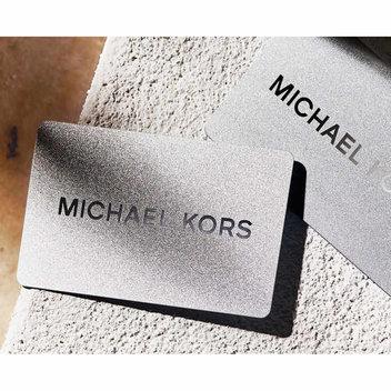 Get 1 of 3 Michael Kors £500 vouchers