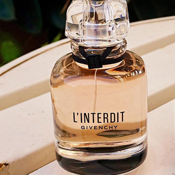 Get your hands on a mini bottle of Givenchy Perfume