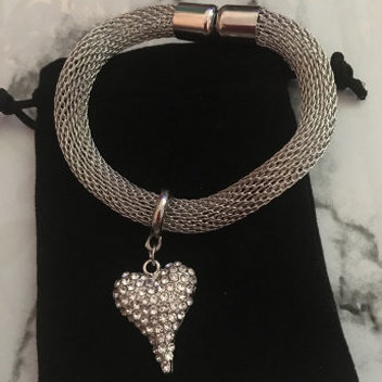 Accessorize with a free Artemis heart Bracelet & Earring set