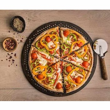 Grab a free pizza at NKD Pizza's opening