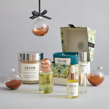 Grab a free Wellbeing Boosting Travel Candle from Neom