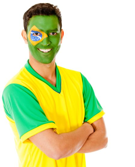 Man with Brazil flag painted on his face and smiling ���� isolated