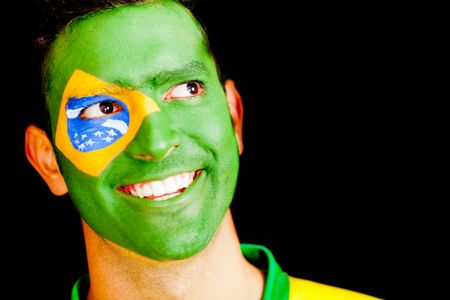Happy man from Brazil with the Brazilian flag painted on his face