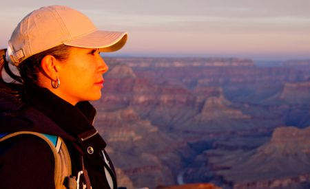 Beautiful woman at the Grand Canyon looking enjoying sunset