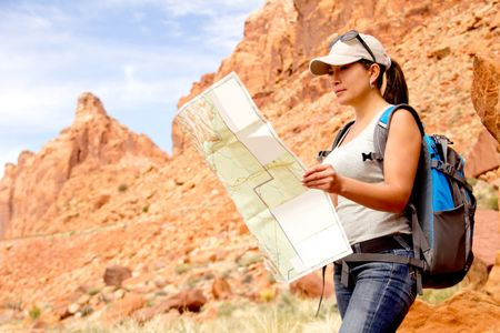Woman exploring at the Grand Canyon with a map