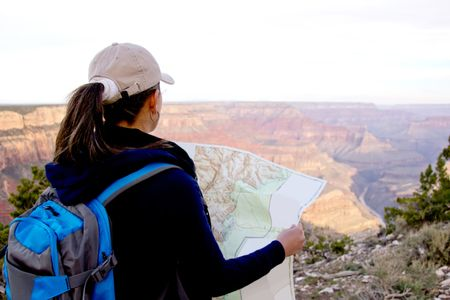 Adventurous female at the Grand Canyon holding a map