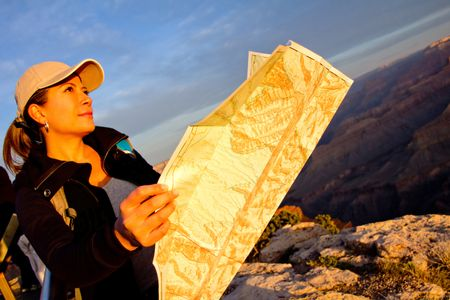 Female explorer with a map at the Grand Canyon
