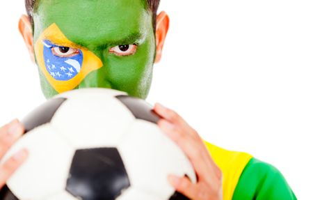 Brazilian football fan holding a ball - isolated over a hwite background