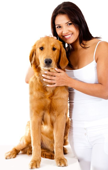 Woman smiling with a cute dog - isolated over a white background