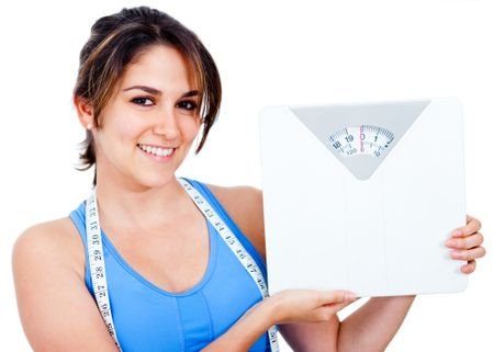 Woman loosing weight and holding a scale - isolated