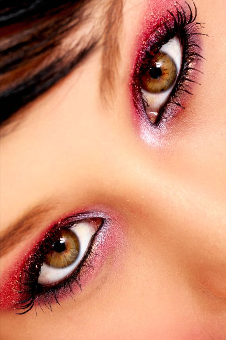 beautiful female eyes with violet make up