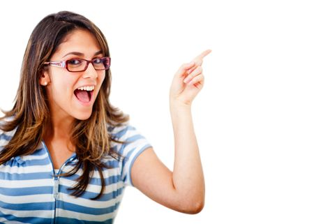 Excited woman pointing an idea with her finger - isolated over white