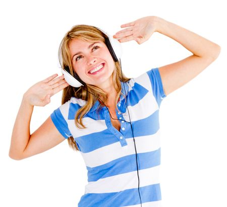 Woman excited about music wearing headphones - isolated over white