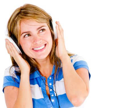 Girl listening to music - isolated over a white background
