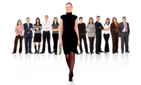 business woman walking and leading the team in front of the group isolated over a white background