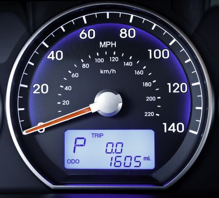 Speedometer in parked car, with LCD display of odometer and trip calculator