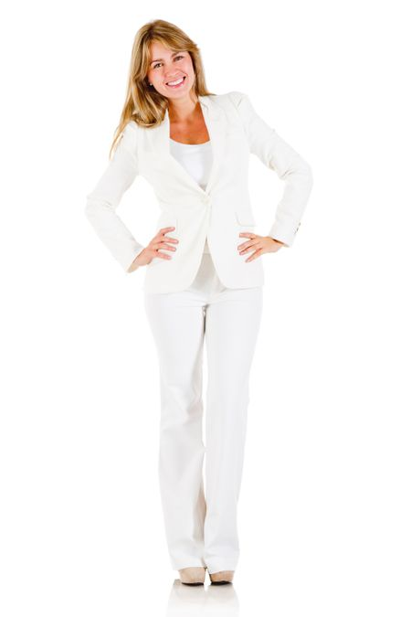 Happy business woman standing isolated over a white background