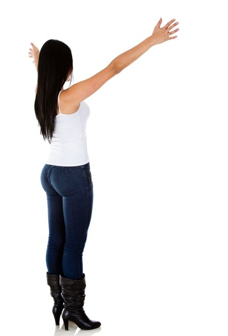 Rear view of a woman with arms open - isolated over white