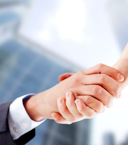 Business handshake closing an important deal
